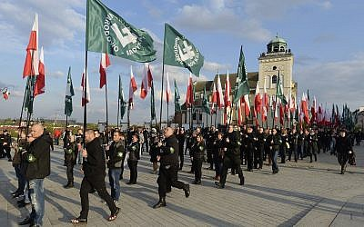 This file photo taken April 29, 2017, shows members of the far-right group, the National-Radical Camp, marking the 83rd anniversary of their organization, in Warsaw, Poland.  (AP/Czarek Sokolowski)