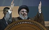 In this Aug. 2, 2013, file photo, Hezbollah leader Hassan Nasrallah gestures during a rally to mark Jerusalem day or Al-Quds day, in a southern suburb of Beirut, Lebanon (AP Photo/Hussein Malla, File)