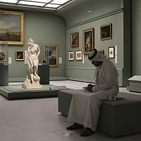 An Emirati man next to the Bather, also called Venus, statue by Christophe-Gabriel Allegrain, 1710-1795, at the Louvre Museum in Abu Dhabi, United Arab Emirates, December 19, 2017. (AP Photo/Kamran Jebreili)