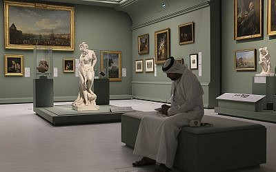 An Emirati man next to the Bather, also called Venus statue by Christophe-Gabriel Allegrain, 1710-1795, at the Louvre Museum in Abu Dhabi, United Arab Emirates, December 19, 2017. (AP Photo/Kamran Jebreili)