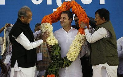 India's opposition Congress party president Rahul Gandhi, center is presented with a garland, during a meeting in Ahmadabad, India,Dec. 23, 2017. (AP/Ajit Solanki)