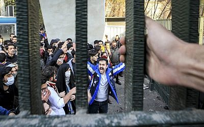 In this Dec. 30, 2017 file photo, taken by an individual not employed by the Associated Press and obtained by the AP outside Iran, university students attend an anti-government protest inside Tehran University, in Tehran, Iran. (AP)