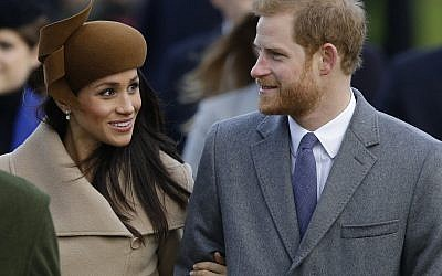 Prince Harry and his fiancee Meghan Markle as they arrive to attend the traditional Christmas Day service at St. Mary Magdalene Church in Sandringham, England. (AP Photo/Alastair Grant/File)