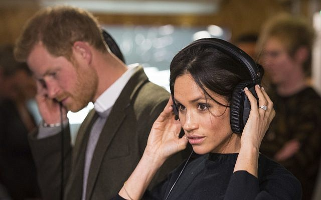Britain's Prince Harry and his fiancee Meghan Markle during a visit to the Reprezent 107.3 FM radio station in Brixton, south London, January 9, 2018. (AP Photo/ Dominic Lipinski, Pool)