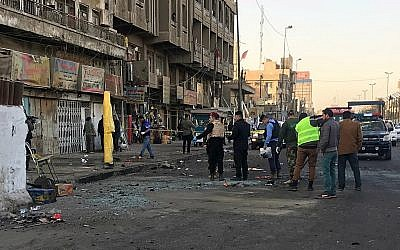 Iraqi security forces gather at the scene of a double suicide bombing in Baghdad, Iraq, January 15, 2018. (AP Photo/Ali Abdul Hassan)