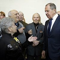 "Russia's Foreign Minister Sergei Lavrov, right, meets with Russian Holocaust survivors at ""The Holocaust: Annihilation, Liberation, Rescue"" exhibit in the United Nations headquarters in New York, January 18, 2018. (AP Photo/Richard Drew)"