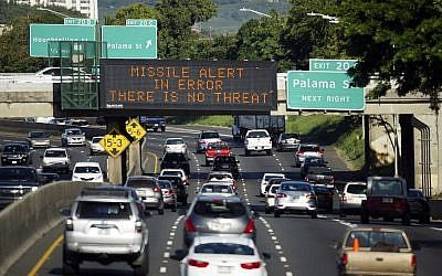 "In this Jan. 13, 2018, file photo provided by Civil Beat, cars drive past a highway sign that says ""MISSILE ALERT ERROR THERE IS NO THREAT"" on the H-1 Freeway in Honolulu. (Cory Lum/Civil Beat via AP, File)"