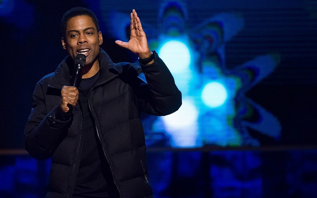 Comedian Chris Rock performs at Comedy Central's 'Night of Too Many Stars: America Comes Together for Autism Programs' in New York, February 28, 2015. (Photo by Charles Sykes/Invision/AP, File)