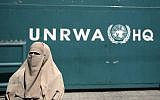 Illustrative: A Palestinian stands outside the UN Relief and Works Agency (UNRWA) headquarters in Gaza City, August 16, 2015. (AP Photo/Khalil Hamra/File)