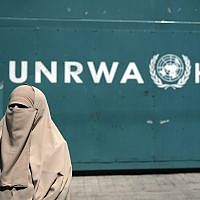 Illustrative: A Palestinian stands outside the UN Relief and Works Agency (UNRWA) headquarters in Gaza City, Sunday, Aug. 16, 2015. (AP Photo/Khalil Hamra)