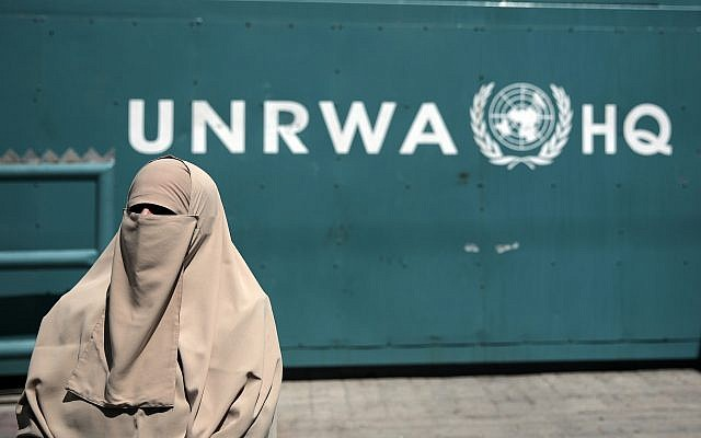 Illustrative: A Palestinian woman outside the UN Relief and Works Agency (UNRWA) headquarters in Gaza City, August 16, 2015. (AP Photo/Khalil Hamra/File)