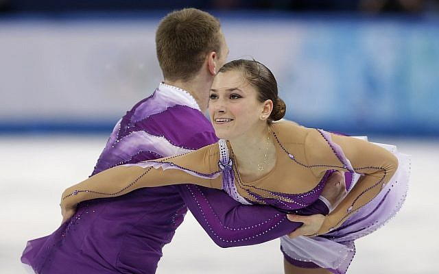 Andrea Davidovich and Evgeni Krasnopolski of Israel compete in the pairs short program figure skating competition at the Iceberg Skating Palace during the 2014 Winter Olympics, Tuesday, Feb. 11, 2014, in Sochi, Russia. (AP Photo/Darron Cummings)