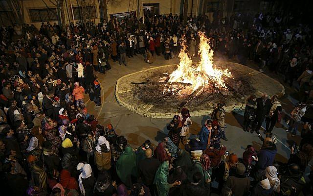Iranian Zoroastrians gather around a giant bonfire in a ceremony celebrating their ancient mid-winter Sadeh festival in Tehran, Iran, Friday, January 30, 2015. (AP/Vahid Salemi)