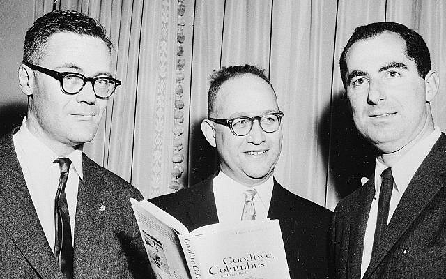 The three winners of the National Book Award are seen as they pose at the Astor Hotel in New York City, March 24, 1960. Robert Lowell, left, was awarded for the most distinguished book of poetry, Richard Ellmann, center, won in the nonfiction categ