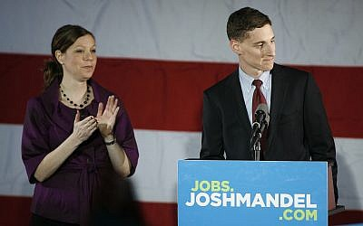 With his wife Ilana next to him, Republican US Senate candidate Josh Mandel concedes defeat to Sherrod Brown on election night in the ballroom at the Renaissance Hotel in Columbus, Ohio on Tuesday, Nov. 6, 2012. (AP Photo/Mike Munden)