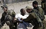 African migrants clash with Israeli soldiers after they left Holot detention center in southern Israel and walked towards the Border with Egypt near the southern Israeli Kibbutz of Nitzana, Friday, June, 27, 2014. (AP Photo/Tsafrir Abayov)