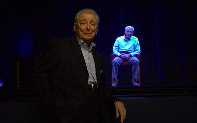 Aaron Elster stands in front of his hologram. (Ron Gould/via JTA)