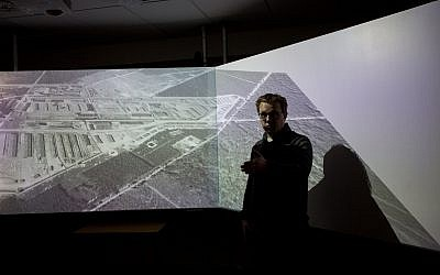 At the Westerbork museum in the Netherlands, Bas Kortholt demonstrates a new virtual reality simulation based on the former Nazi transit camp's appearance during the Holocaust (Elan Kawesch/The Times of Israel)