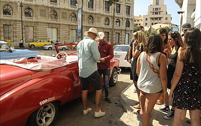 Israeli tourists negotiate with a taxi driver at the cruise ship terminal in Old Havana. (Larry Luxner/Times of Israel)
