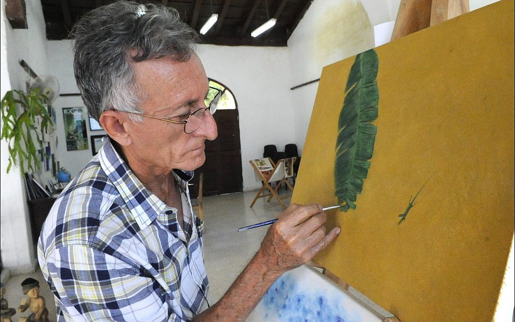 Prominent Jewish artist Orestes Larios Zaak, owner of the Galeria Larios in downtown Camagüey. (Larry Luxner/Times of Israel)