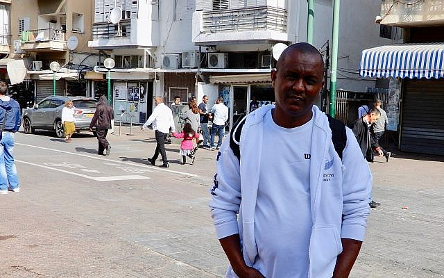 Actvist Bluts Iyassu Zeru in south Tel Aviv on January 13, 2018, prior to a weekly meeting of Eritreans United for Justice, an opposition group dedicated to uniting diaspora Eritreans in order to overthrow the Eritrean dictator. (Melanie Lidman/Times of Israel)