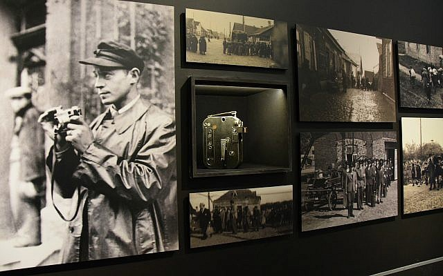 View of section of 'Flashes of Memory' exhibition at Yad Vashem showing image of photographer Zvi Hirsch Kadushin (later George Kaddosh) in the Kovno ghetto, his camera, and some of the photos he smuggled out after going into hiding before the ghetto's liquidation. (Courtesy of Yad Vashem)