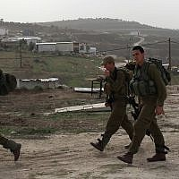 IDF soldiers patrol the Gilad Farm illegal West Bank settlement outpost on December 2, 2009. (Kobi Gideon/Flash90)