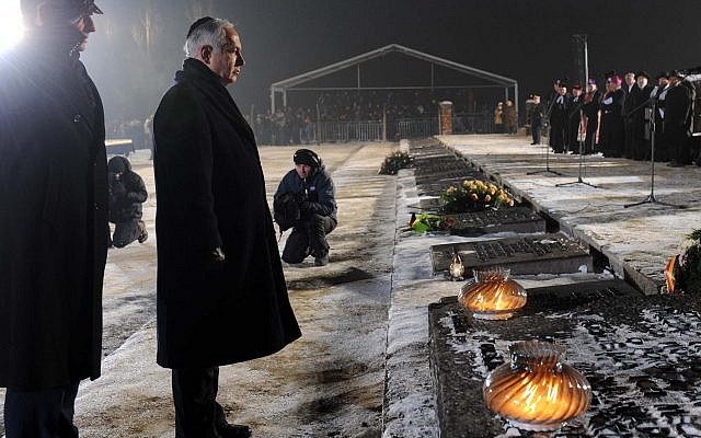 Prime Minister Benjamin Netanyahu lays a wreath at a memorial ceremony marking the 65th anniversary of the liberation of Auschwitz camp and to honor the victims of the Holocaust, in Auschwitz Birkenau, Poland, on International Holocaust Memorial Day. January 27, 2010. Avi Ohayon/Government Press Office/FLASH90)