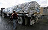 Illustrative: UN trucks carrying building materials for projects funded by UNRWA arrive in Rafah in the southern Gaza Strip after crossing the Israeli Kerem Shalom crossing on December 10, 2013. (Abed Rahim Khatib/ Flash90/ File)