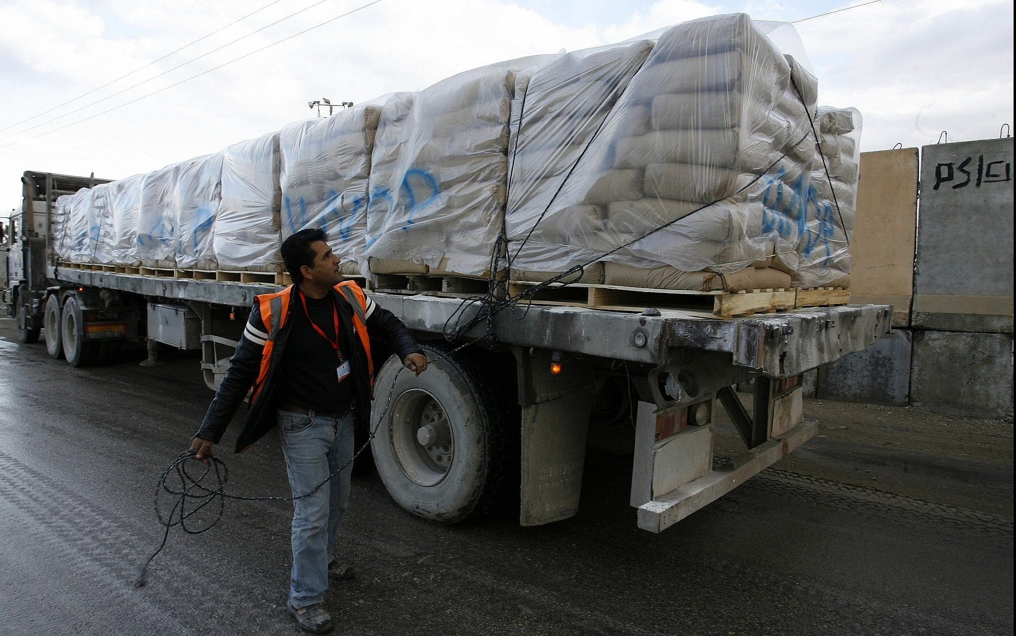 UN trucks carrying building materials for projects funded by UNRWA arrive in Rafah in the southern Gaza Strip after crossing the Israeli Kerem Shalom crossing