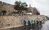 Slovakian professional cyclist Peter Sagan, Jerusalem Mayor Nir Barkat and Israel's Cycling Academy ride near the Old City of Jerusalem on November 26, 2014. (Yonatan Sindel/Flash90)