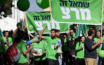 Members and activists of the Meretz party march on Rothschild boulevard in central Te Aviv on January 30, 2015, ahead of the Knesset elections. (Ben Kelmer/Flash90)
