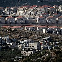 Illustrative photo of the ultra-Orthodox West Bank settlement of Beitar Illit, and the Arab village of Wadi Fukin below, June 17, 2015. (Nati Shohat/Flash90)