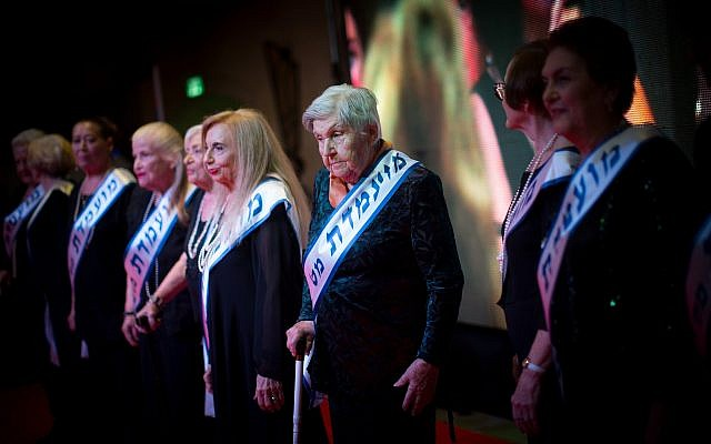 Holocaust survivors participate in a beauty pageant contest, in the northern Israeli city of Haifa, November 24, 2015. (Illustrative: Yonatan Sindel/Flash90)