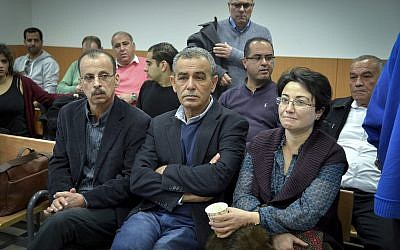 Balad party MKs Hanin Zoabi, right, and Jamal Zahalka, center, both of the Joint (Arab) List Faction, seen at the court hearing of fellow faction member MK Basel Ghattas at the Rehovot Magistrate's Court, January 5, 2017. (Avi Dishi/Flash90)