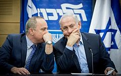 Prime Minister Benjamin Netanyahu (right) speaks with Energy Minister Yuval Steinitz during a Likud party meeting at the Knesset on May 29, 2017. (Yonatan Sindel/Flash90)