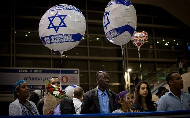 Family members of Ethiopian Jews wait their arrival at Ben Gurion airport, outside of Tel Aviv on June 06, 2017. (Miriam Alster/Flash90.)