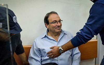 Rishon Lezion Mayor Dov Zur arrives for extension of his remand at the Rishon Lezion Magistrate's Court, December 7, 2017. (Avi Dishi/Flash90)