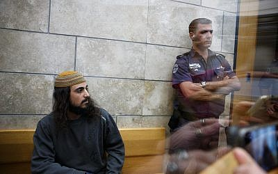 Yinon Reuveni (L) attends his sentencing for at the Nazareth Magistrate's Court on December 12, 2017. (Basel Awidat/Flash90)