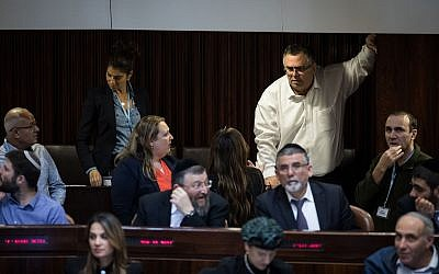 Former coalition chairman David Bitan (right) stands in the Knesset on December 27, 2017 (Hadas Parush/Flash90)