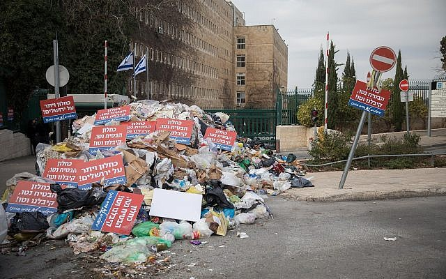 A pile of garbage left by Jerusalem city workers in front of the Finance Ministry as part of the municipality's dispute with the ministry over funding, on December 31, 2017. (Hadas Parush/Flash90)