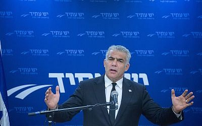 Head of the Yesh Atid party MK Yair Lapid leads a faction meeting at the Knesset, on January 01, 2018. (Miriam Alster/Flash90)
