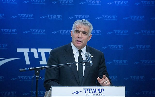 Yesh Atid party leader Yair Lapid heads a faction meeting at the Knesset on January 1, 2018. (Miriam Alster/Flash90)