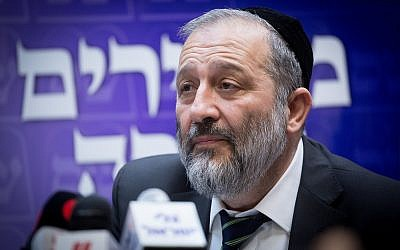 Leader of the Shas party Interior Minister Aryeh Deri leads a party faction meeting at the Knesset, January 01, 2018. (Miriam Alster/Flash90)