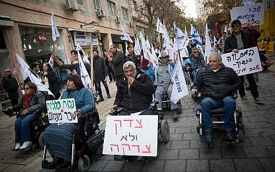 Disabled, handicapped and other activists march in central Jerusalem, as they protest for better health care and allowances, on January 3, 2018. (Yonatan Sindel/Flash90)
