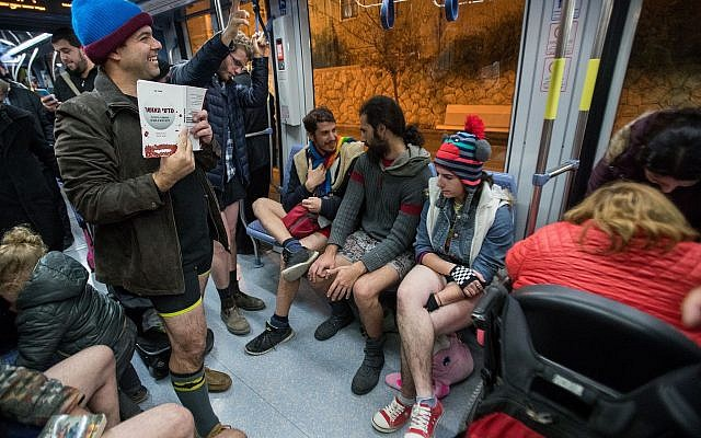 "People participate in the event of ""No Pants Subway Ride"" an annual tradition that started in New York in 2002, and is now a global event in the Jerusalem Light Rail on January 7, 2018. (Yonatan Sindel/Flash90)"