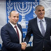 Finance Minister Moshe Kahlon (r) and Education Minister Naftali Bennett, at a press conference regarding the reduction in vacation days in the education system at the Finance Ministry in Jerusalem on January 8, 2018. (Hadas Parush/Flash90)