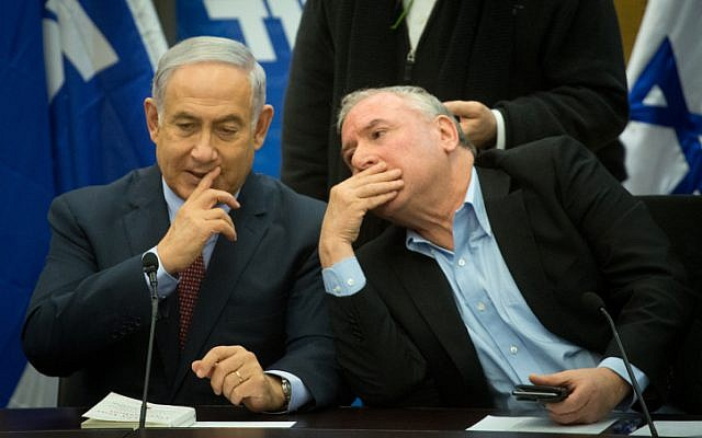Prime Minister Benjamin Netanyahu and MK David Amsalem during a Likud party faction meeting at the Knesset on January 8, 2018. (Miriam Alster/Flash90)