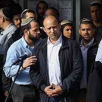 Education Minister Naftali Bennett attends the funeral of Rabbi Raziel Shevah, 35, in the West Bank outpost of Havat Gilad on January 10, 2018. (Miriam Alster/Flash90)