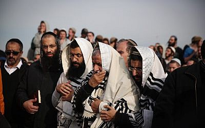 Friends and family attend the funeral of Rabbi Raziel Shevach, 35, in the West Bank outpost of Havat Gilad on January 10, 2018. (Miriam Alster/Flash90)